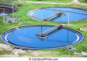 Blue water in an industrial wastewater treatment circular settlers