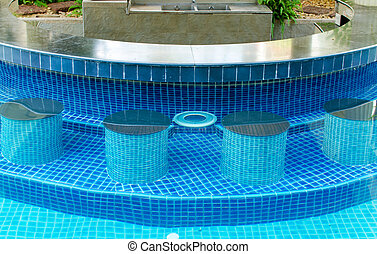 Blue water in hotel swimming pool with bar