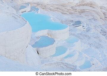 Blue water in Pamukkale travertine pools