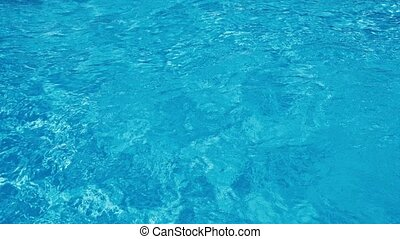 Blue water rippled background in swimming pool. 4K.