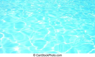 Blue Water Ripples Fastly in Swimming Pool under Bright Sun. Speed up.