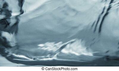 Blue water splash. Slow motion