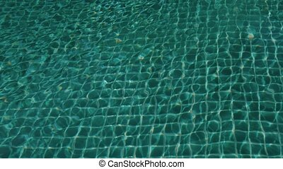 Blue water surface with swimming pool. Water ripples and...