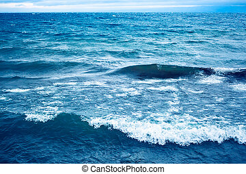 Blue water surface with waves