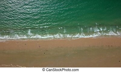 Blue water washing sand - Aerial shot from above of tropical...