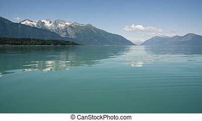 Blue waters of Southeast Alaska near the Chilkat Inlet on a sunny day.