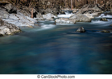 Blue Waters Rush Through Boulder Filled Creek Bed