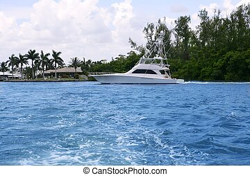 Blue waterway in Florida with fishing boat Pompano Beach