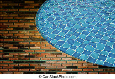 Blue wave water in Swimming pool and wall background