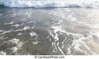 Blue waves surfing on ocean tropical beach. 4K high...