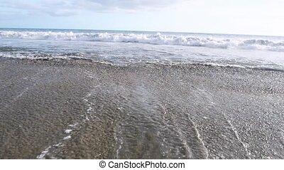 Blue waves surfing on ocean tropical beach