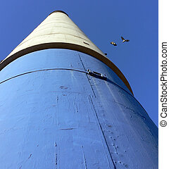 Blue, White and Black Chimney with Pigeons