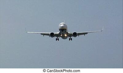 blue white landing jet fly over