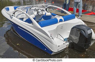 blue white modern cutter moored