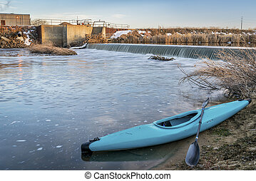 blue whitewater kayak and river diversion dam - St Vrain Creek near Platteville in northern Colorado
