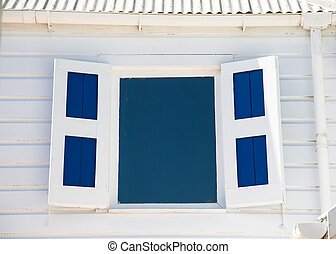 Blue Window and Shutters in White Wood Wall