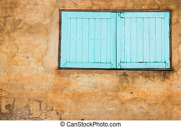 blue window on the old wall with space