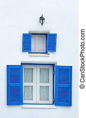 blue window on the white wall