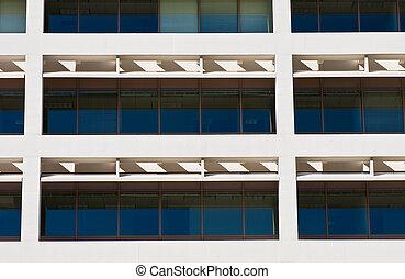 Blue Windows Behind White Columns