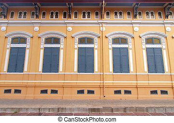 Blue windows with yellow wall  - Oriental style