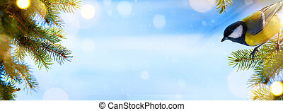 Blue winter Christmas background with trees branch and holidays lights