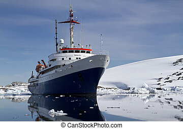 blue with white tourist ship summer day in Antarctic waters