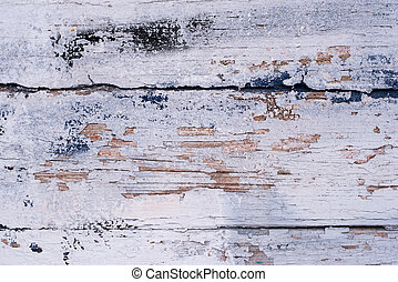 Old wooden painted surface with spots and flaky paint