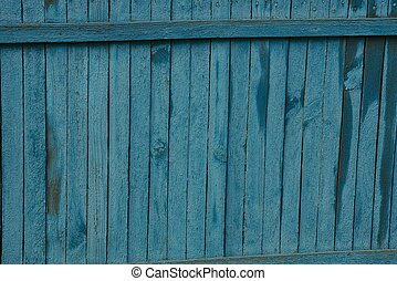 blue wooden background of old thin fence