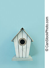 Blue wooden bird house on a white background