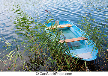 Blue wooden boat on lake