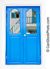 Blue wooden door on white wall