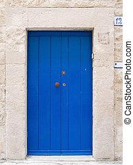 Blue wooden frontdoor.