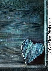 Blue wooden heart on wood
