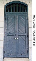 Blue wooden vintage door on white