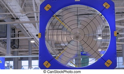 Blue working industrial fan during work at techology...