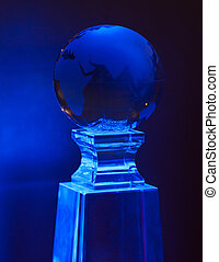 Blue world ball on a glass base