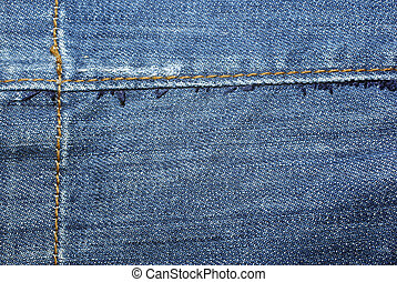Blue worn jeans with yellow stitches close up. Background or backdrop.