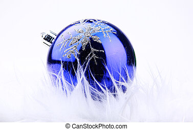 Blue xmas ornament on bright holiday background