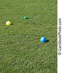 Blue Yellow and Green Bocce Balls in Grass