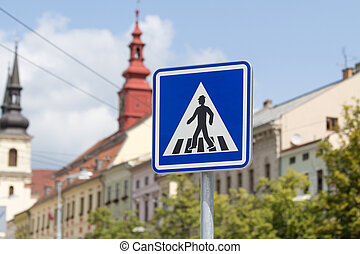 Blue zebra crossing sign in a city