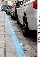 blue zone and parked cars