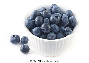 Blueberries - Bowl of blueberries, isolated on white. Close-...