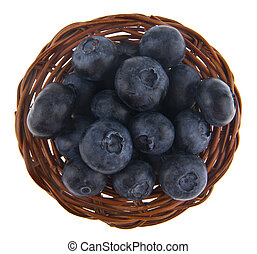 blueberries in a basket isolated on white background close-up
