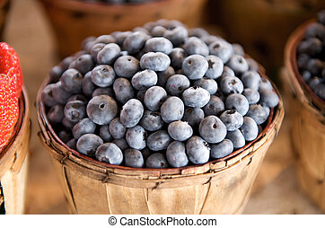 Blueberries in a basket on a open market stall
