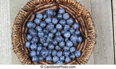 Blueberries in a basket on a wooden board some