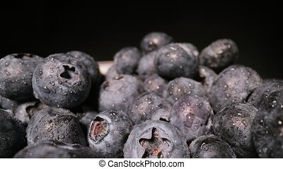 Blueberries in a pile wide angle macro sliding shot, probe lens 60 fps