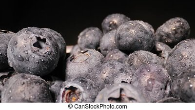 Blueberries in a pile wide angle macro sliding shot, probe lens