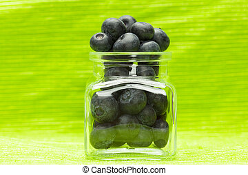 blueberries in the bank on a green background