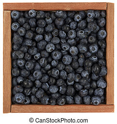 blueberries in wooden box