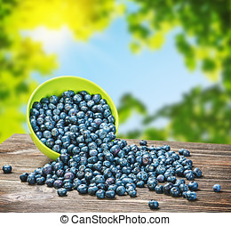 Blueberries ? ??????? is scattered on the wooden table